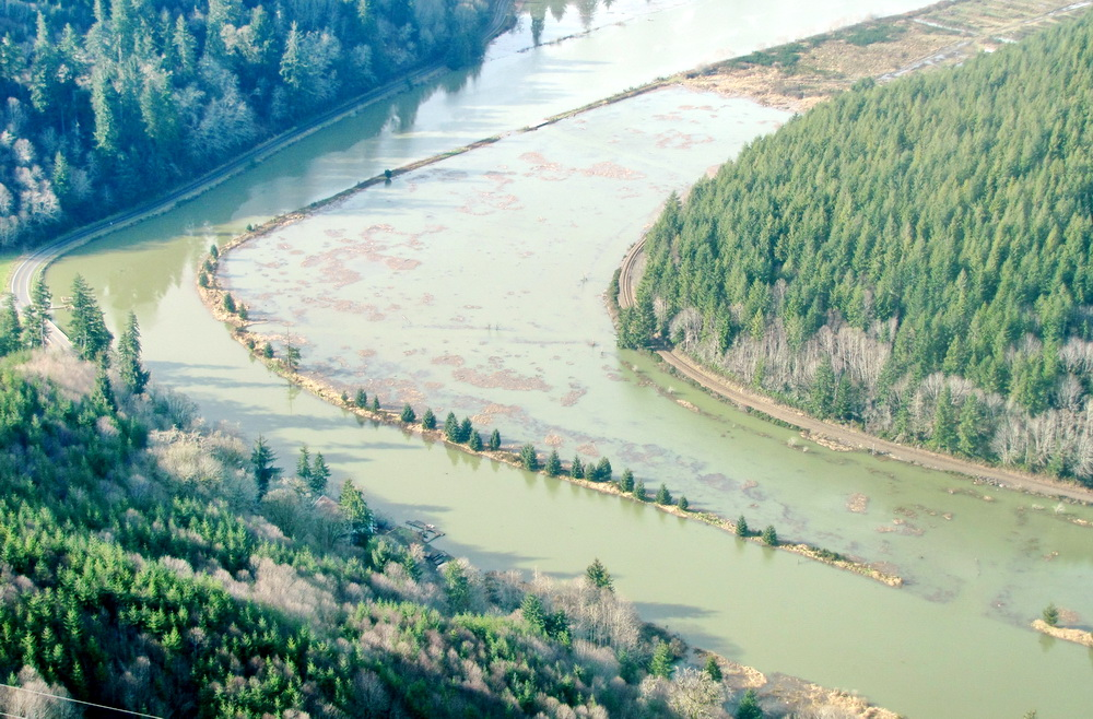 A king tide, driven by sea level rise, swamps wetlands along the Yaquina River near Newport.\Photo by John Bauer.