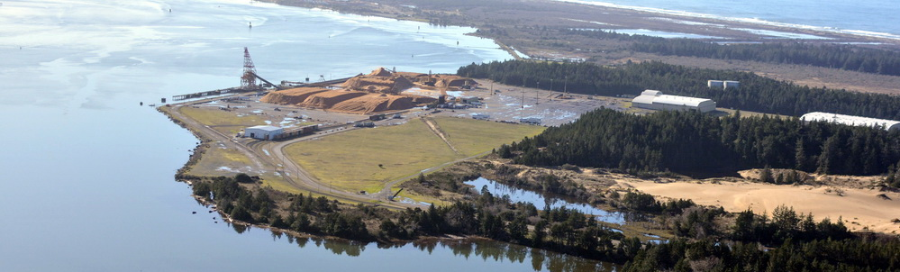 Coos Bay's North Spit, with Roseburg Forest Product's chip export facility in foreground and Jordan Cove beyond that.\Photo by Alex Derr.
