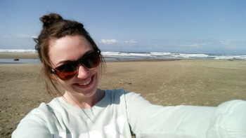 CoastWatch intern Sabrina Ehler takes a selfie on the shore.