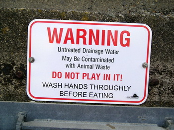Photo of water quality warning sign.