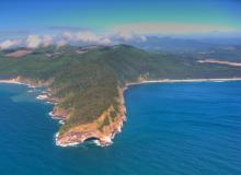 Aerial photo of Cape Lookout from the sea, showing Boy Scout camp property just south of the Cape. Photo by Alex Derr.