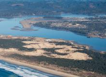 Photo of the North Spit at Coos Bay and the Jordan Cove Site. Photo by Alex Derr.