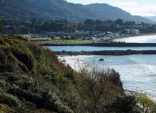 Chetco River jetties at high tide.\Photo by Lawrence Witt.