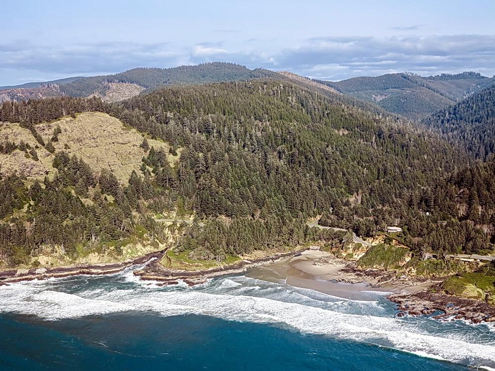 Cape Perpetua, with Visitors Center to the right.\Photo by Alex Derr.