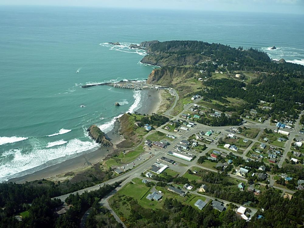 Port Orford, with Battle Rock in center.\Photo courtesy of ODFW.