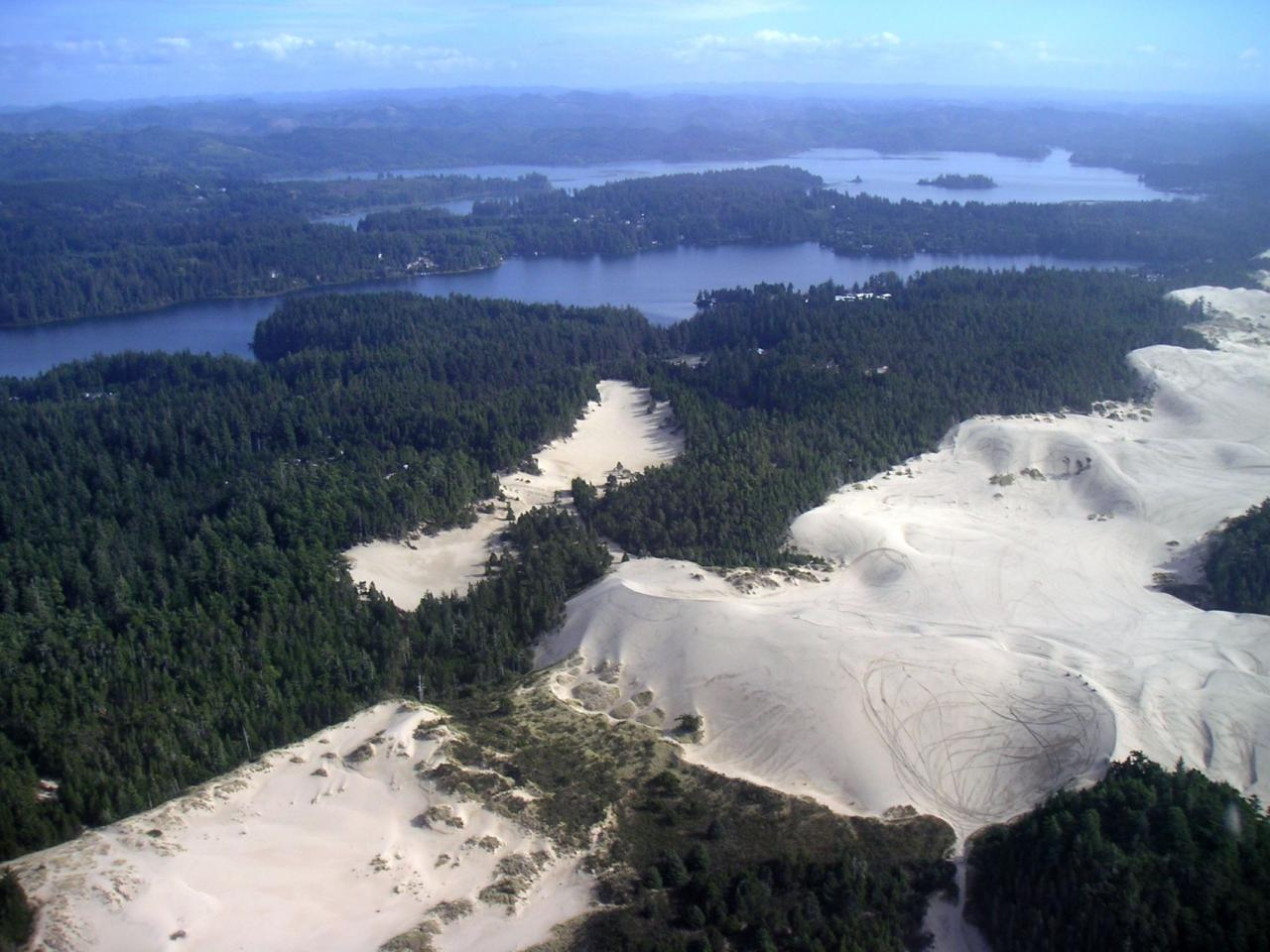 Tahkenitch Lake and Dunes from the air.\Photo by Alex Derr.