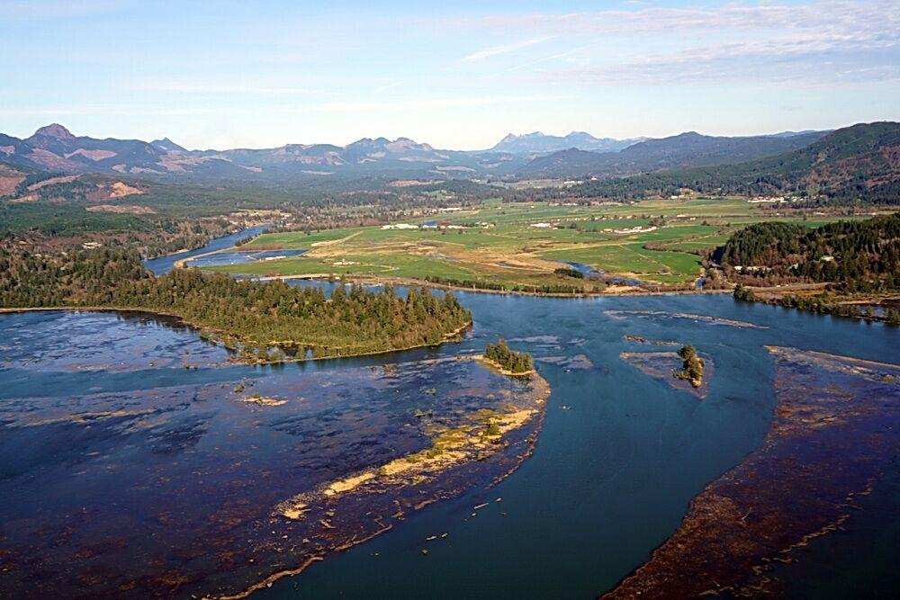 The Nehalem's estuary, from the air during a king tide.|Photo by Briana Goodwin.