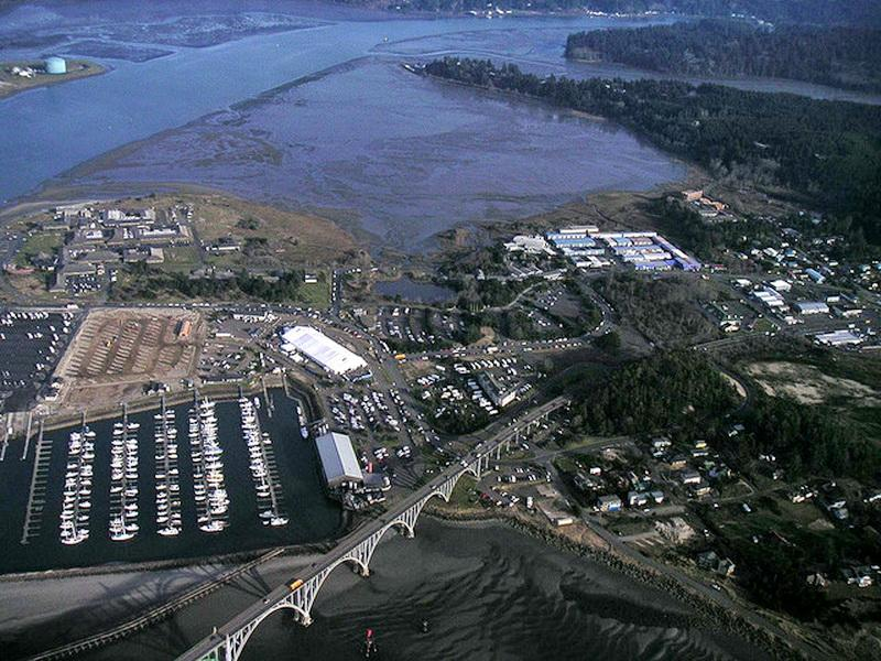 Lower Yaquina Bay, with the Oregon Coast Aquarium to the right.  Photo by Alex Derr.