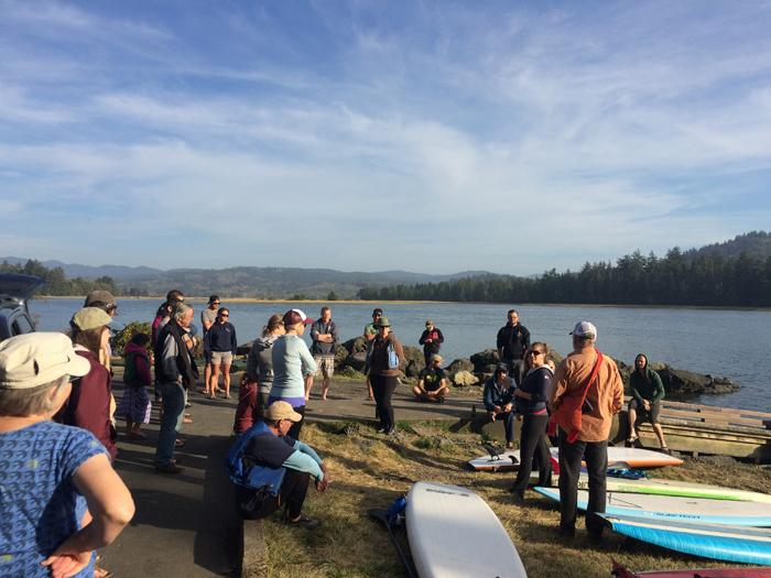 Surfrider volunteers meeting before paddleboarding in Oregon.