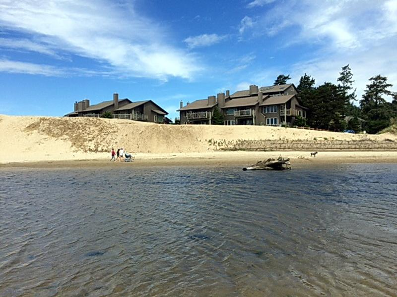 Breakers Point Condominiums, viewed across Ecola Creek, and the dune in question. Photo by Marc Bates.