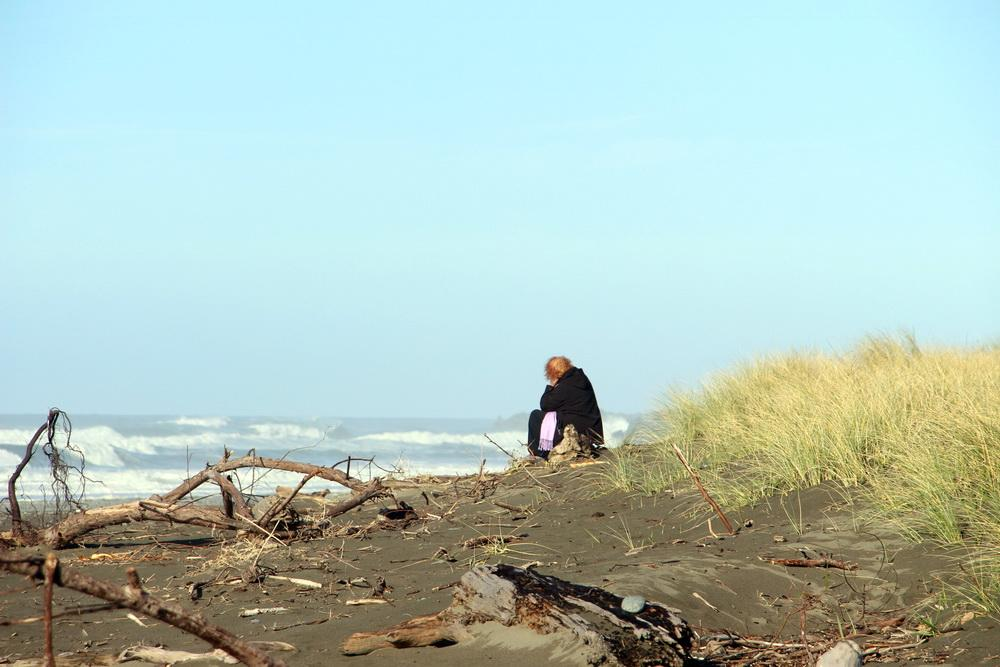 Beachgoer contemplates CoastWatch Mile 28.|Photo from CoastWatch report.