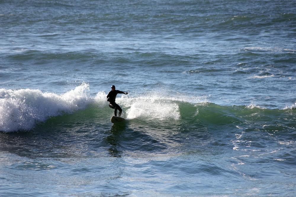 One use of the Territorial Sea--surfer at Devils Punchbowl.\Photo by Sara Schreiber.