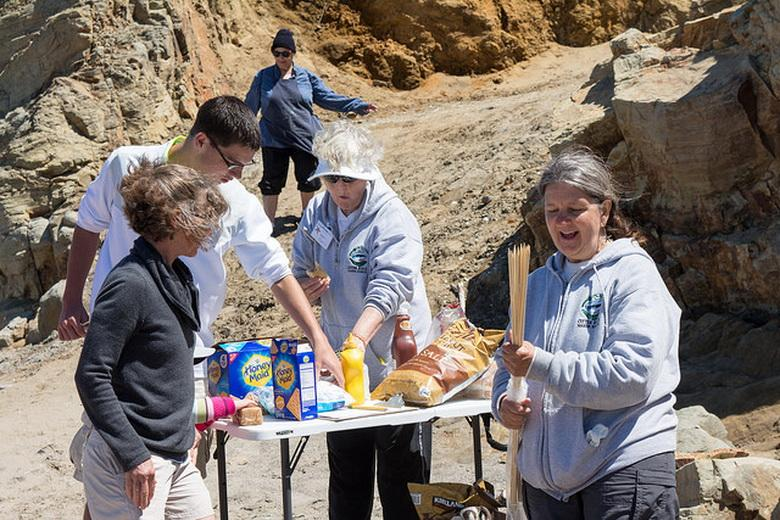 Karen Driscoll (center), with Fawn Custer at a Community Science Day at Otter Rock.\Photo by Alex Derr.