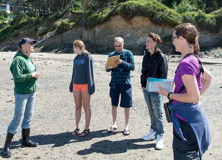 Athena Crichton, left, leads a CoastWatch training session.\Photo by Alex Derr.