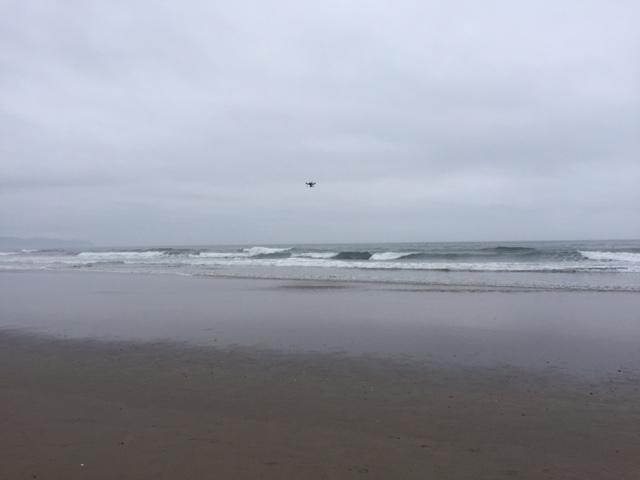 Drone flying over Oceanside beach.