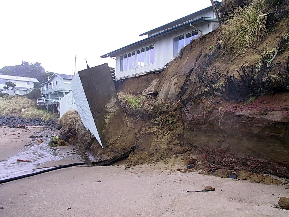 Erosion, leading to impacts such as this collapsed seawall, will increase due to climate change.\Photo courtesy of DOGAMI.