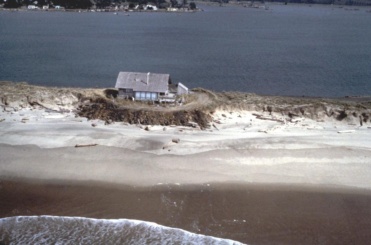 House on spit isolated behind riprap.  Photo courtesy of DOGAMI.
