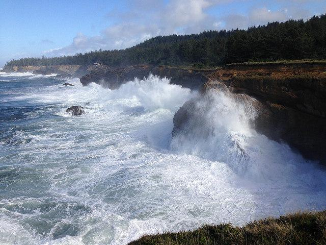 A king tide batters the bluffs at Shore Acres.\Photo by Sally Woodman.