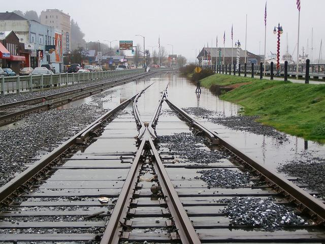 King Tide floods the tracks along the Coos Bay waterfront. Photo by Robert More.