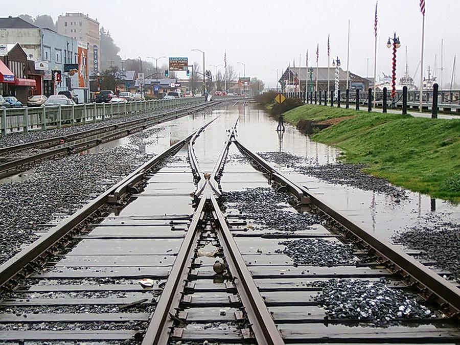A king tide, driven by sea level rise, swamps the tracks in downtown Coos Bay.\Photo by Robert More.