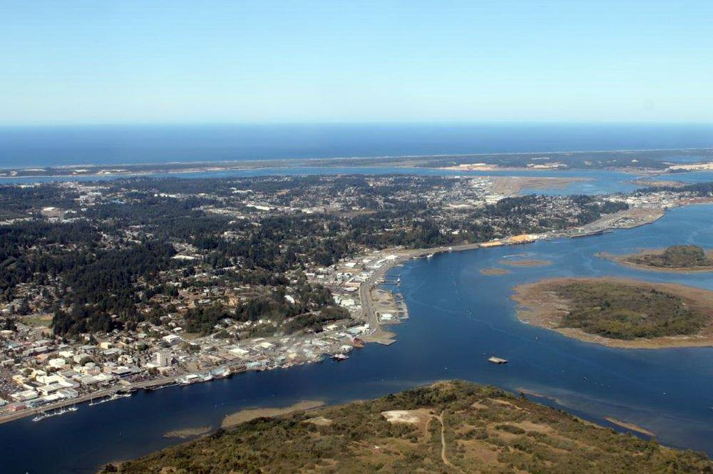 Coos Bay shoreline and estuary, with North Spit in the background.\Photo by Jody McCaffree.