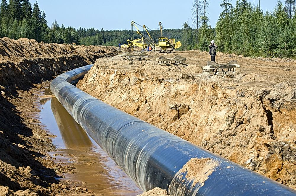 Natural gas pipeline to feed LNG plant under construction.