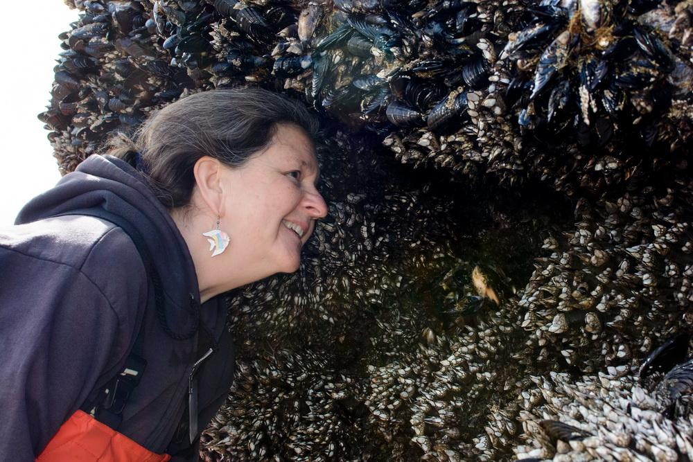 Fawn Custer with her friends, the mussels.\Photo by Alex Derr.