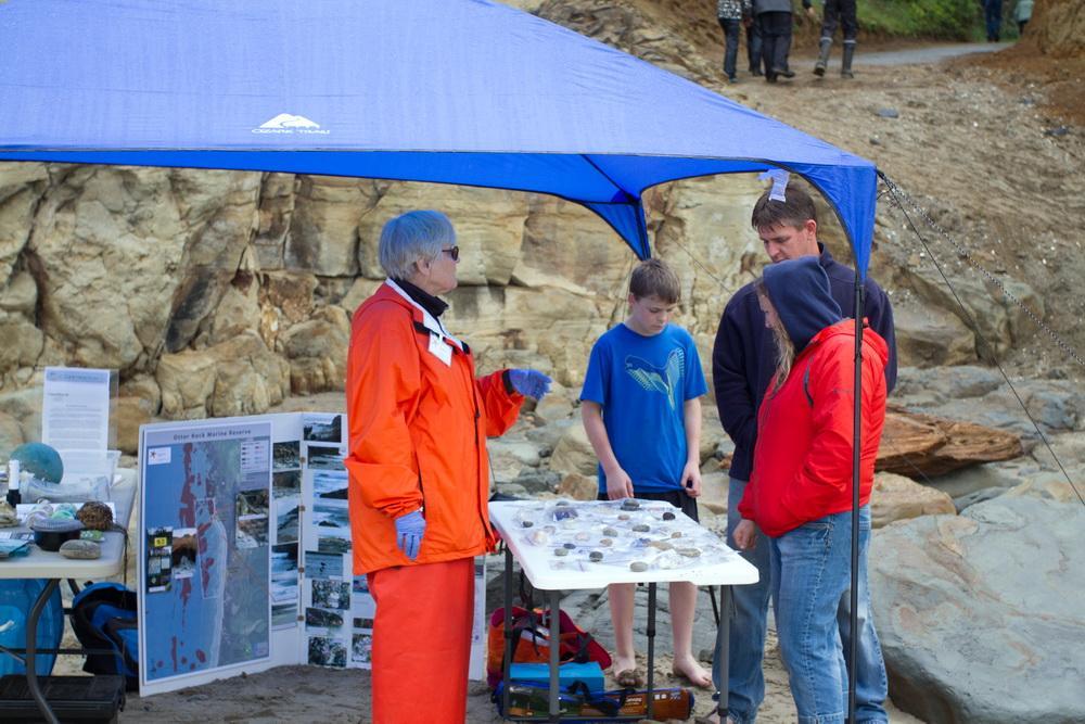 Karen Driscoll, tabling at a recent Otter Rock event.  Photo by Briton Ogden.