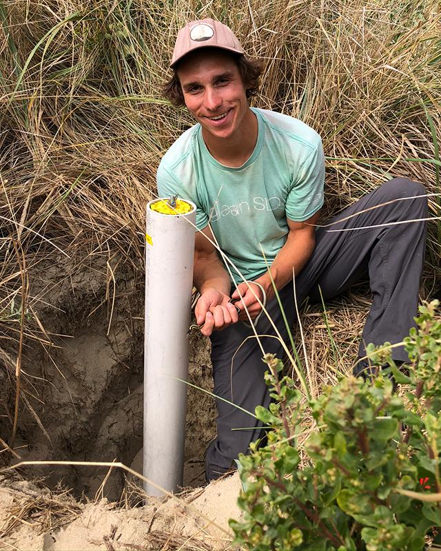John Stepanek in the field, studying carbon storage.