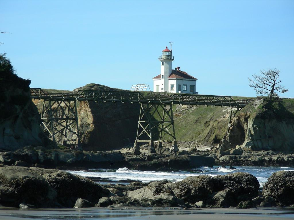Cape Arago Lighthouse as seen from the beach.Photographed by Diane Bilderback