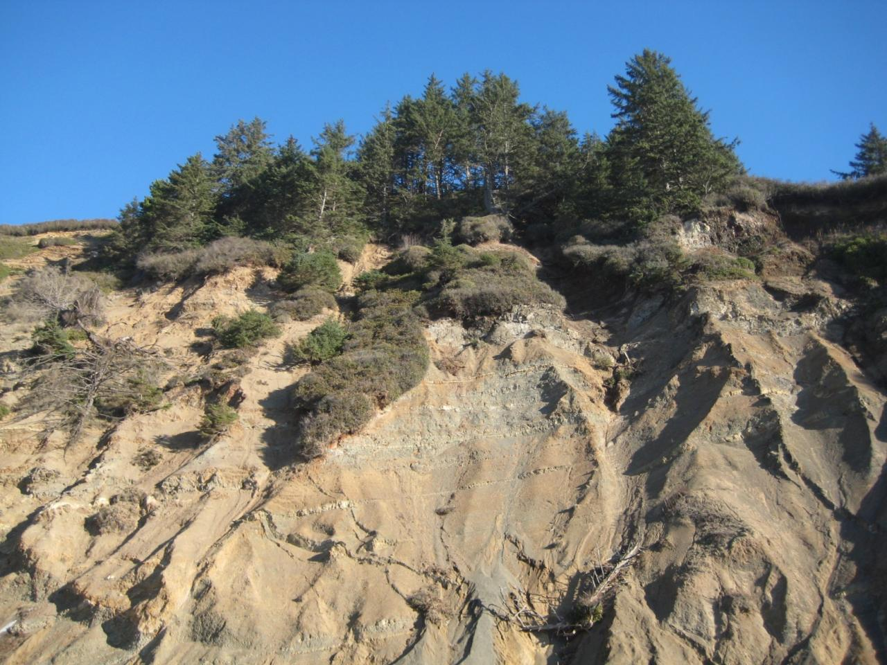 Uplifted basalt cliff face north end of mi 245