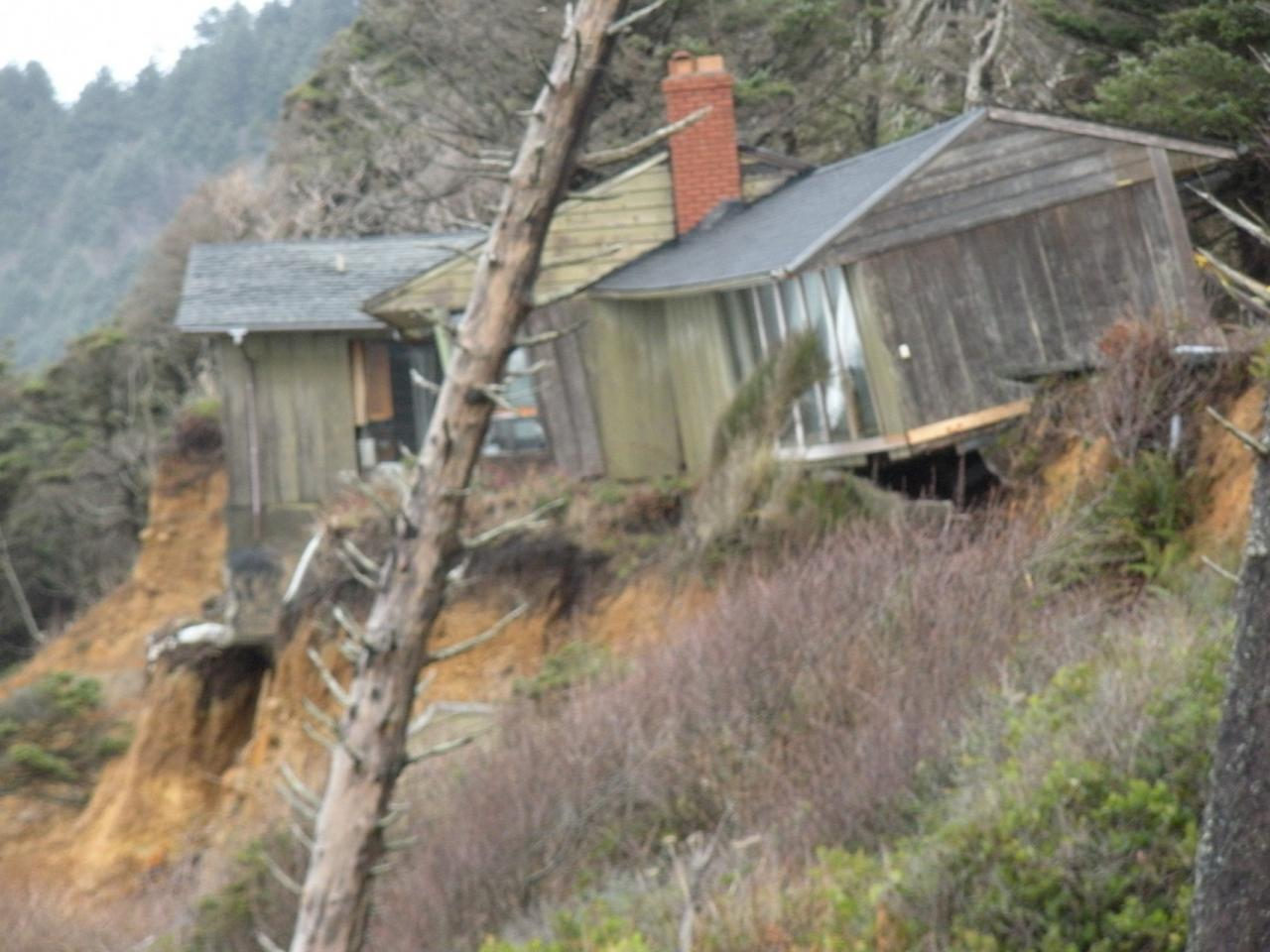 After years of bluff erosion a house is now almost falling to the beach