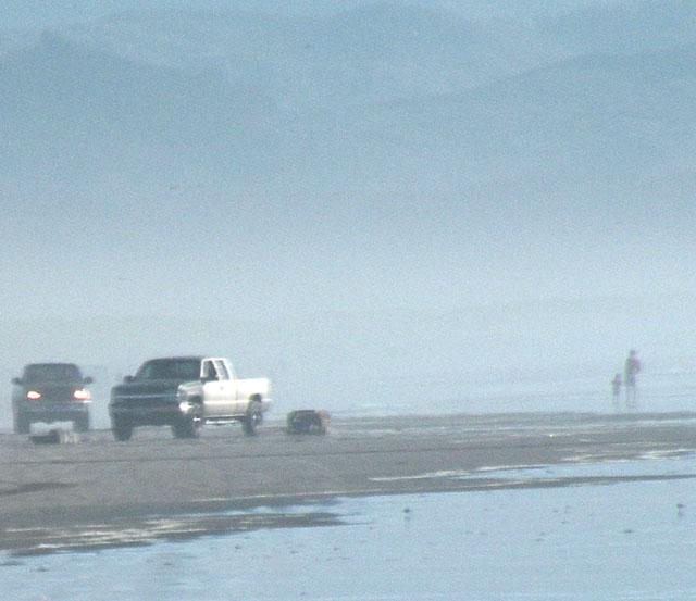 Some jerk dragging a La-Z-Boy recliner around with his truck before dumping it on the beach.