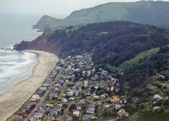 Aerial photo of Roads End, about the year 2000, with Cascade Head in the background
