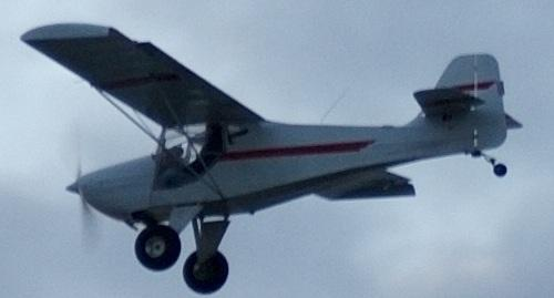 A small, slow home-built plane flew up the beach at about 200 feet. Very quiet, not a problem at all.