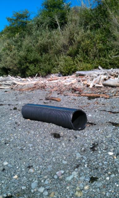 "large storm drain type black PVC pipe aprox. 18"" diameter, 10 feet long"