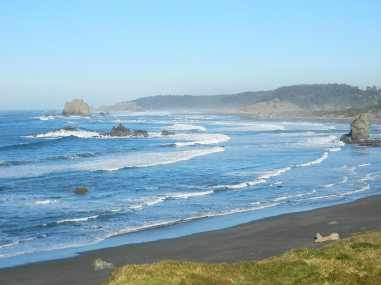 Half way down the beach at North Cape Blanco.  Good day for agates and sea glass, found some white and little green.