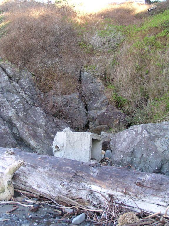 mile 3 found large concrete on beach near cliff