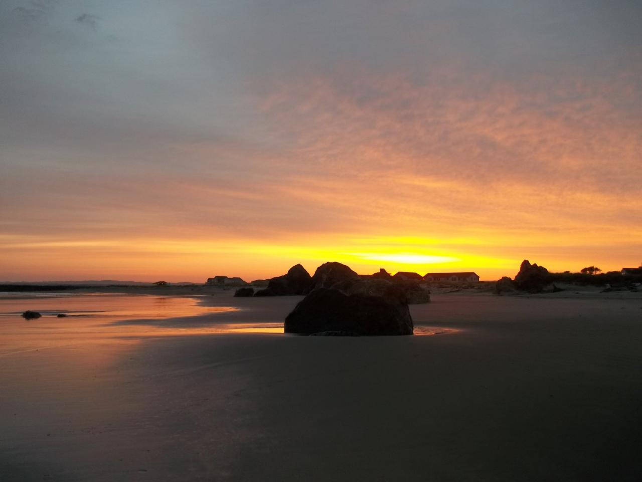The full glory of sunrise over the Coquille River and Mile 102 is one of the many splendors coast walkers can experience.