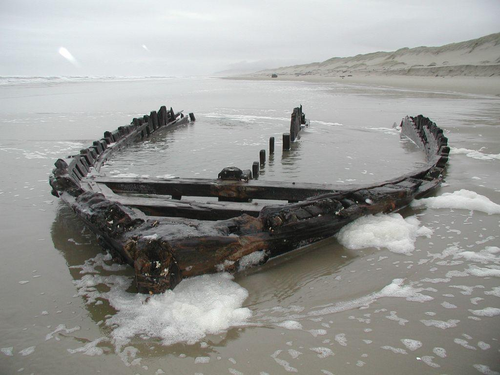 """Bow section of the Florence-based lumber schooner """"Bella"""", blown ashore November, 1905.  Visible during winter low tides, at the Mile 168-169 boundary."""