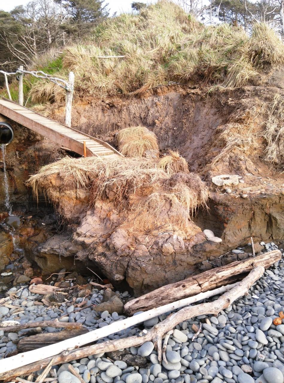 the lower half of the access stairs washed away. the cliff hasn't stabilized.