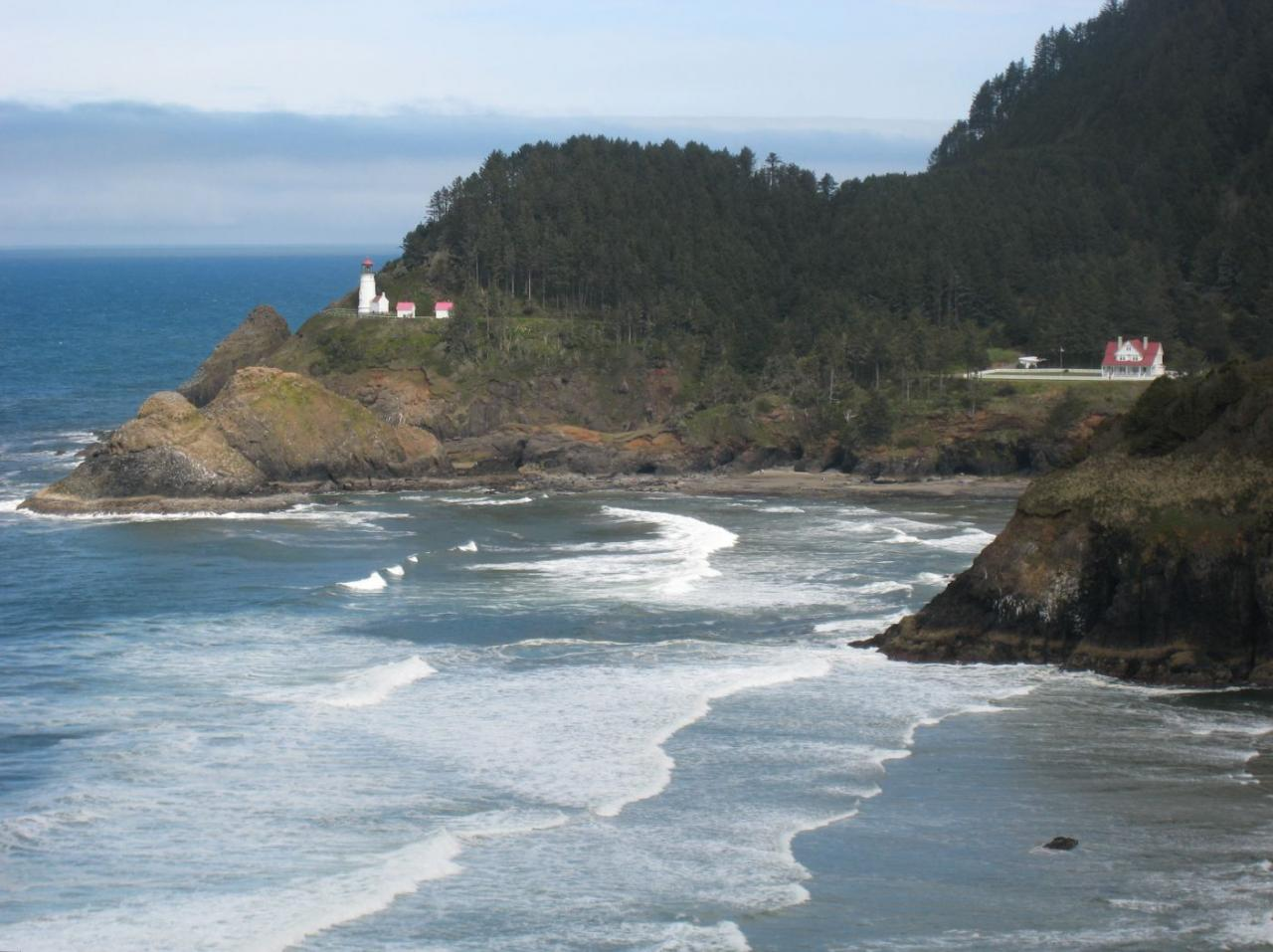 View of Heceta Head, the lighthouse, lighthouse  keepers residence (bed and breakfast), beach  and Devils Elbow.