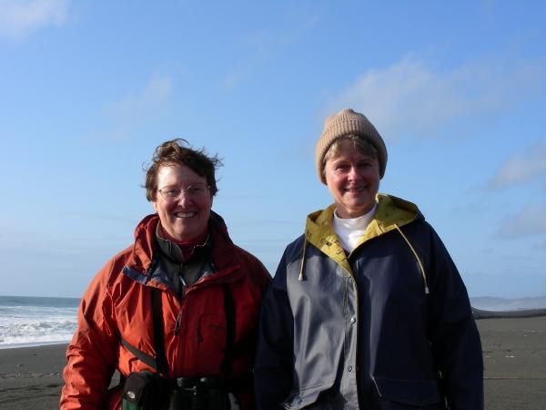 "D. Bilderback (left) ""showing the ropes"" to new coast watcher, C. Strenkoski"