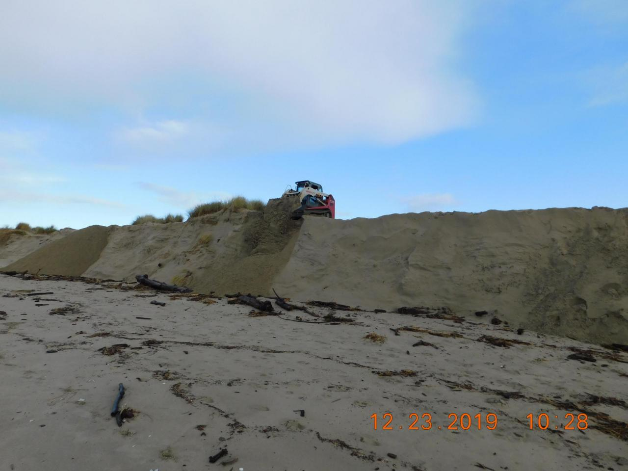 Dumping of sand onto beach on Mile 202, Alsea Spit