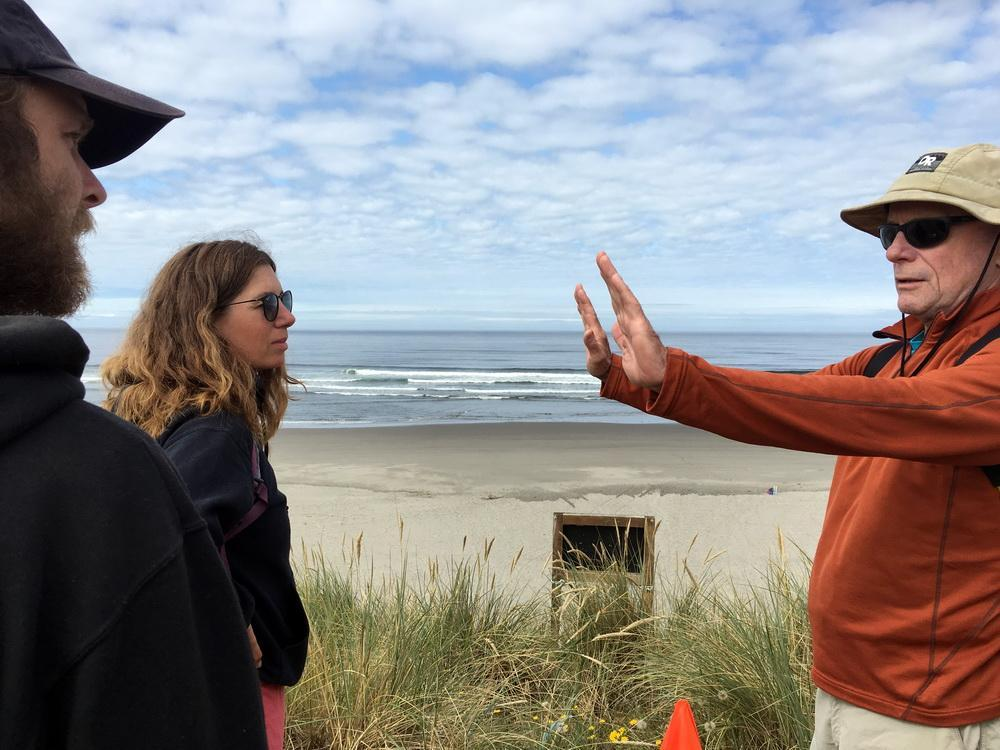 Oregon Shores board member Ed Joyce (right) leads the Fort Stevens marine debris survey.\Photo by Patricia Jensen