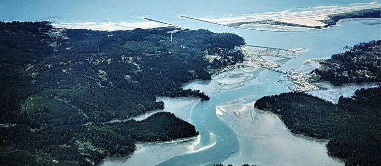 Coos Bay entrance, with South Slough in foreground.\Photo courtesy of Surfrider.