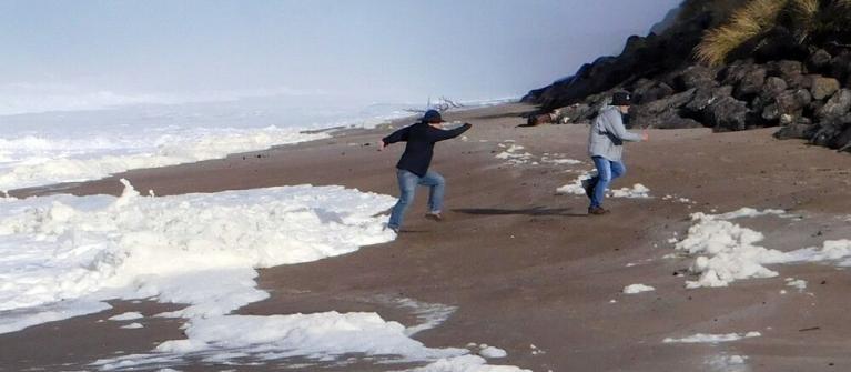 Fleeing a king tide at Gleneden Beach.|Photo by Linda Reid.