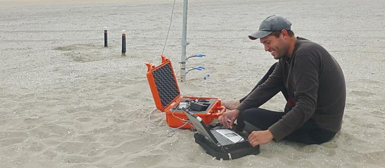 Geologist Nick Cohn sampling the wind at South Beach.