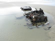 Front view of recently exposed car remains on Wakonda Beach