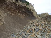 Photo of north edge of Cape Kiwanda, cliff collapsing.